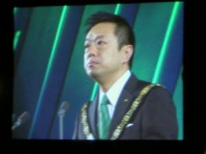 新年式典でスピーチする公益社団法人日本青年会議所会頭福井正興君